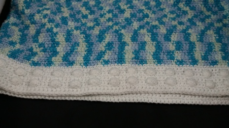 Close up of bobble stitch hem.
