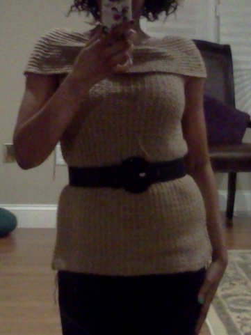 Selfie of me wearing a beige off-the-shoulder crochet sweater, cinched at the waist with a black belt.