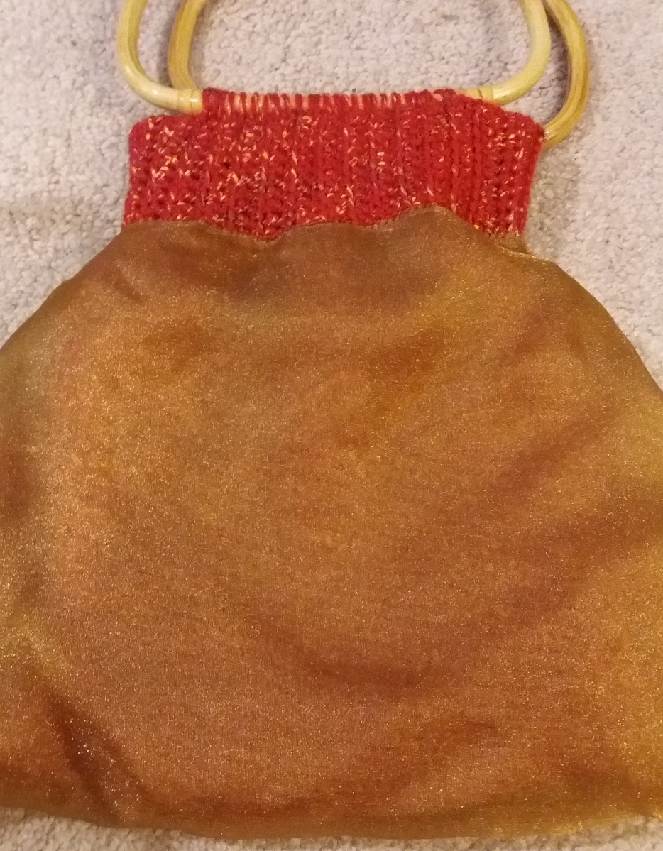 Inside-out bag showing the bronze-colored organza lining.